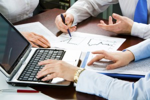 Image of three business people's hands at working meeting